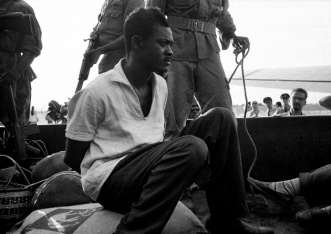 "Patrice Lumumba - before his execution. (Picture by Horst Faas - AP). Patrice Lumumba led the movement for Congo's independence from Belgium (June 1960). Within 10 weeks, the new Congolese Communist Govt. was deposed by a CIA backed-coup. Lumumba's controversial independence day speech reminded that the Congolese were ""Nous ne sommes plus vos macaques!"" (We are no longer your monkeys!)*.  Lumumba escaped from his house arrest, but was rearrested from a plane in Elizabethville, beaten and humiliated in front of diplomats and journalists, put on the truck and taken away. This was Lumumba's last photo. A few weeks later, he was executed, and his body dissolved in acid."