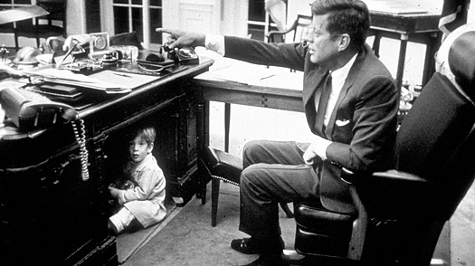 John F. Kennedy Jnr. under the Resolute Desk | Iconic Photos