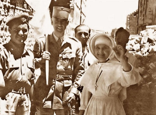 Sister_of_the_St._Louis_Hospital_in_Jerusalem_holding_up_a_denture_recovered_after_having_fallen_out_of_the_window_into_no-man's-land,_22_May_1956.jpg