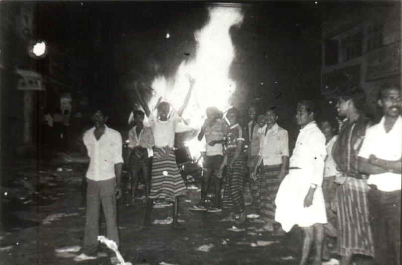 1983-borella-rioters-burning.jpg